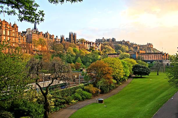 Edinburgh Old Town scene at sunset View of old Edinburgh, Scotland at sunset from Princes Street Gardens princes street edinburgh stock pictures, royalty-free photos & images