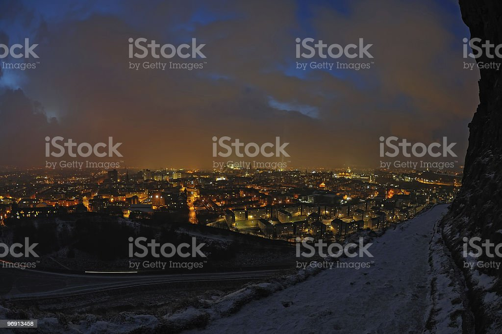 Edinburgh skyline on a snowy winter night royalty-free stock photo