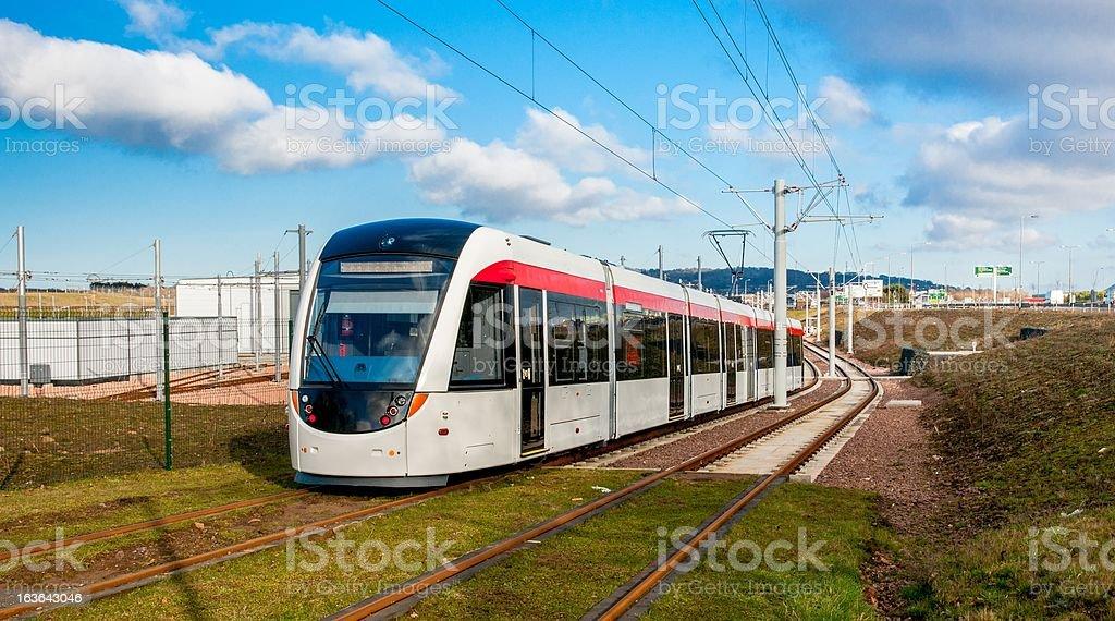 Edinburgh tram heads to its depot at Gogar stock photo