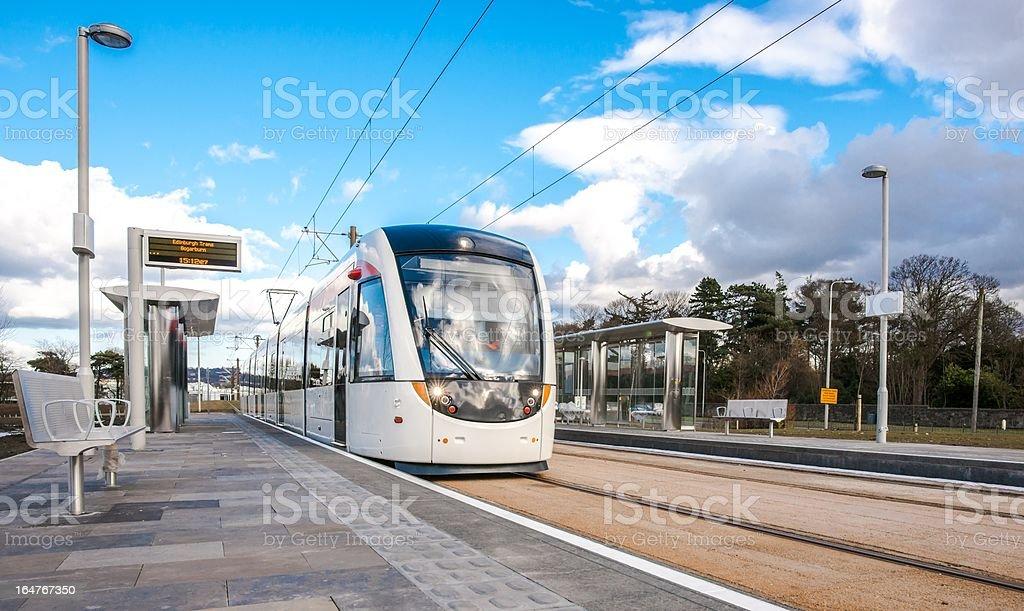 Edinburgh Tram passes through Gogarburn Station stock photo
