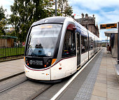 Edinburgh Trams, a light rail mass transit system, moves along the streets of downtown Edinburgh, Scotland