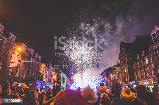 Edinburgh, Scotland - November 19, 2017:  Winter revellers enjoy Edinburgh's Christmas and Hogmanay Festival opening firework display in George Street.