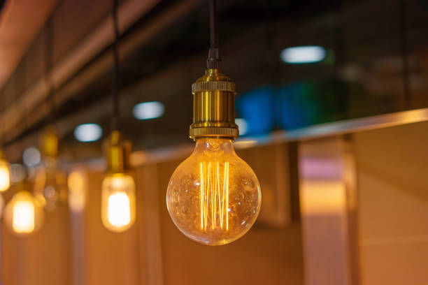 edison lamps in loft interior - alten kronleuchter stock-fotos und bilder