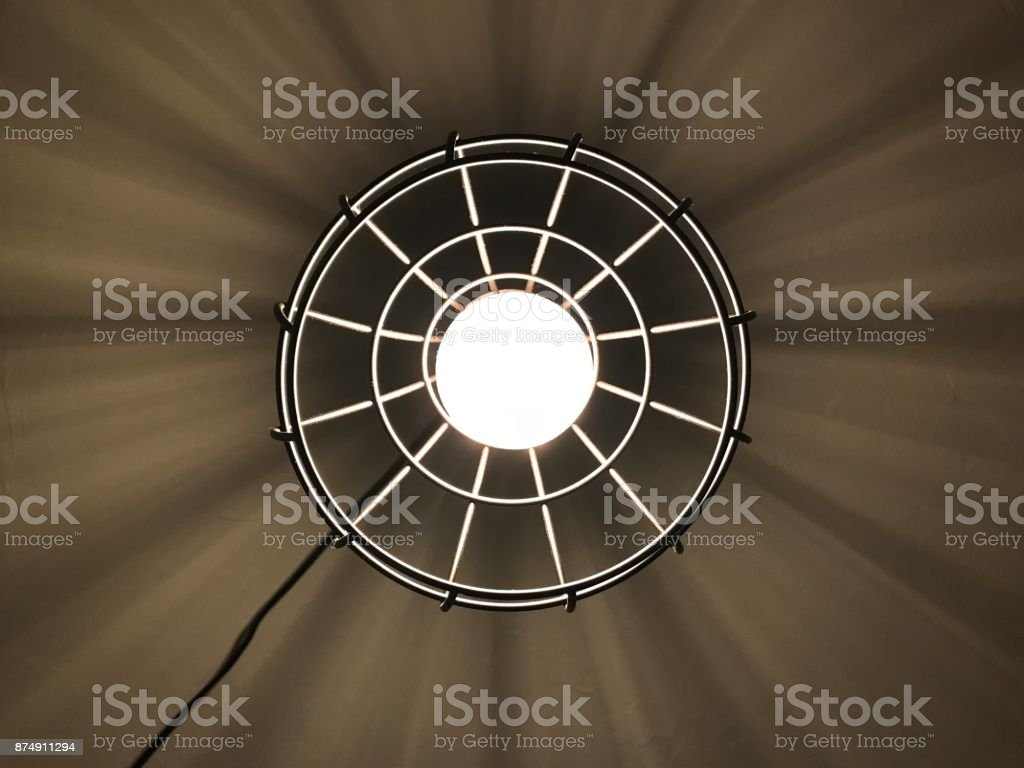 Edison Light Taken directly underneath a hanging Edison bulb Abstract Stock Photo