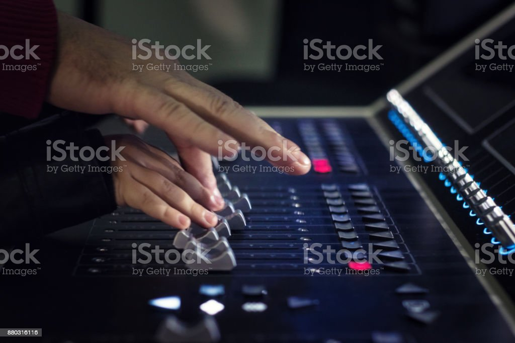 Close up of child editing sound on mixing panel with help of music...