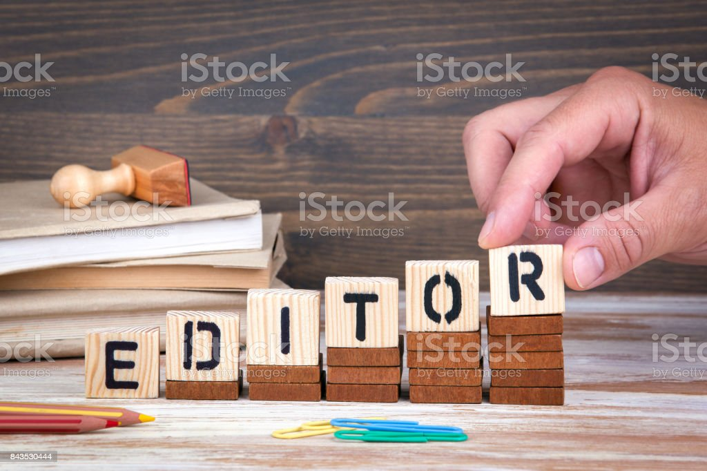 Editor concept. Wooden letters on the office desk, informative and communication background stock photo