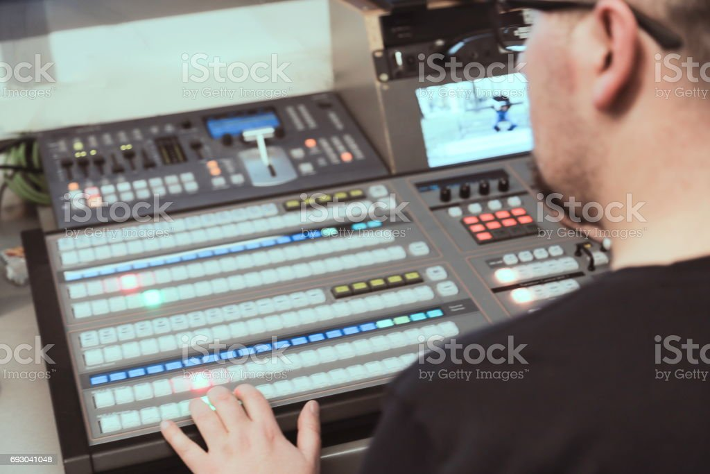 TV editor working with audio video mixer in a television broadcast stock photo