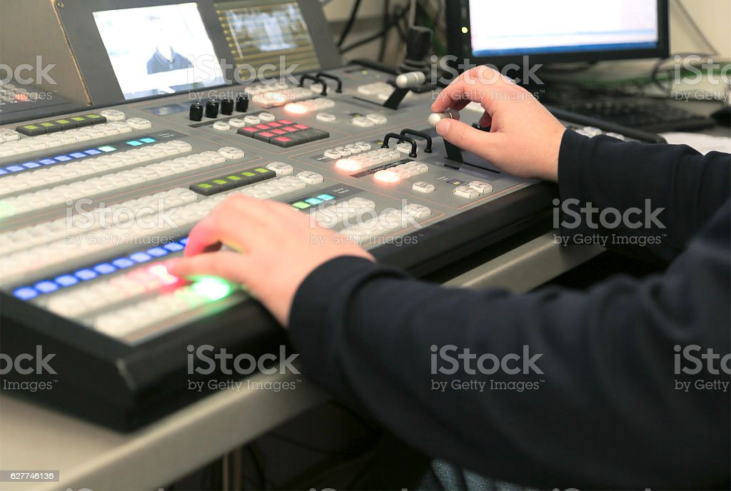 TV editor working with audio video mixer stock photo
