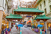 San Francisco, California, USA - December 15, 2018: Tourists visitors and residents at the historic Dragon Gate Arch South Chinatown entrance in San Francisco, California, USA.