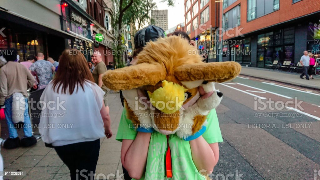 Editorial image of young woman in cosplay outfit standing outside a city bar stock photo
