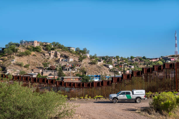 Editorial June 9, 2017 - US Mexico International Border Border fence dividing the United States and Mexico in Nogales, Arizona border patrol stock pictures, royalty-free photos & images
