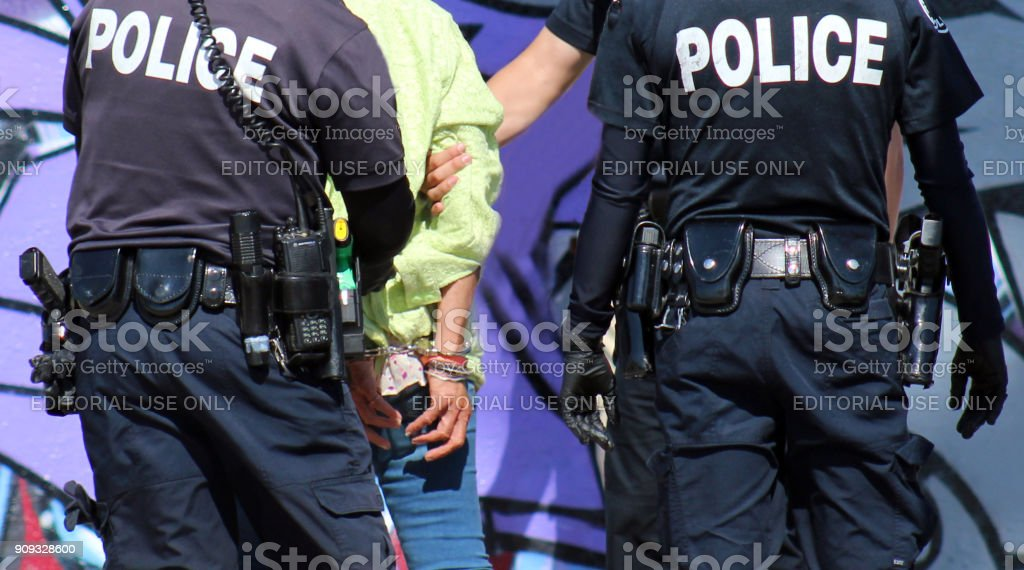 editorial photograph: up close arrest of homeless woman stock photo
