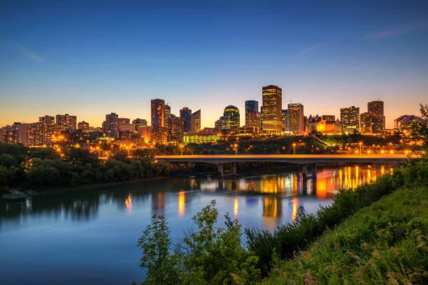 Edmonton downtown and the Saskatchewan River at night stock photo
