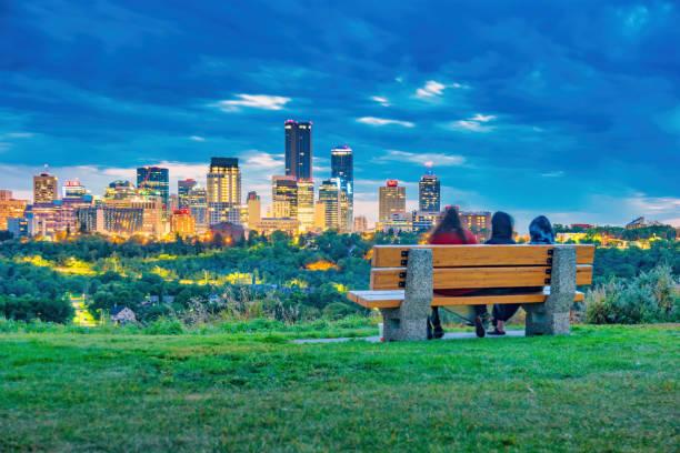 Edmonton Skyline Alberta Canada People relax on bench stock photo