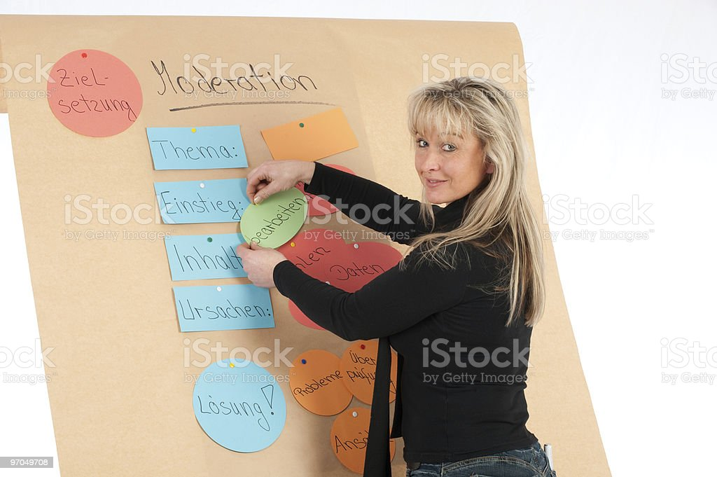 educates young presenter on a flip chart stock photo