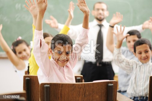 istock Education activities in classroom at school, children with teacher 124018503