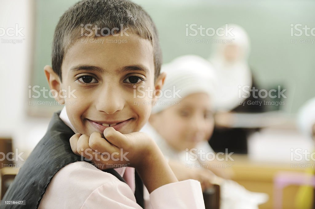 Education activities in classroom at school, happy children with teacher stock photo