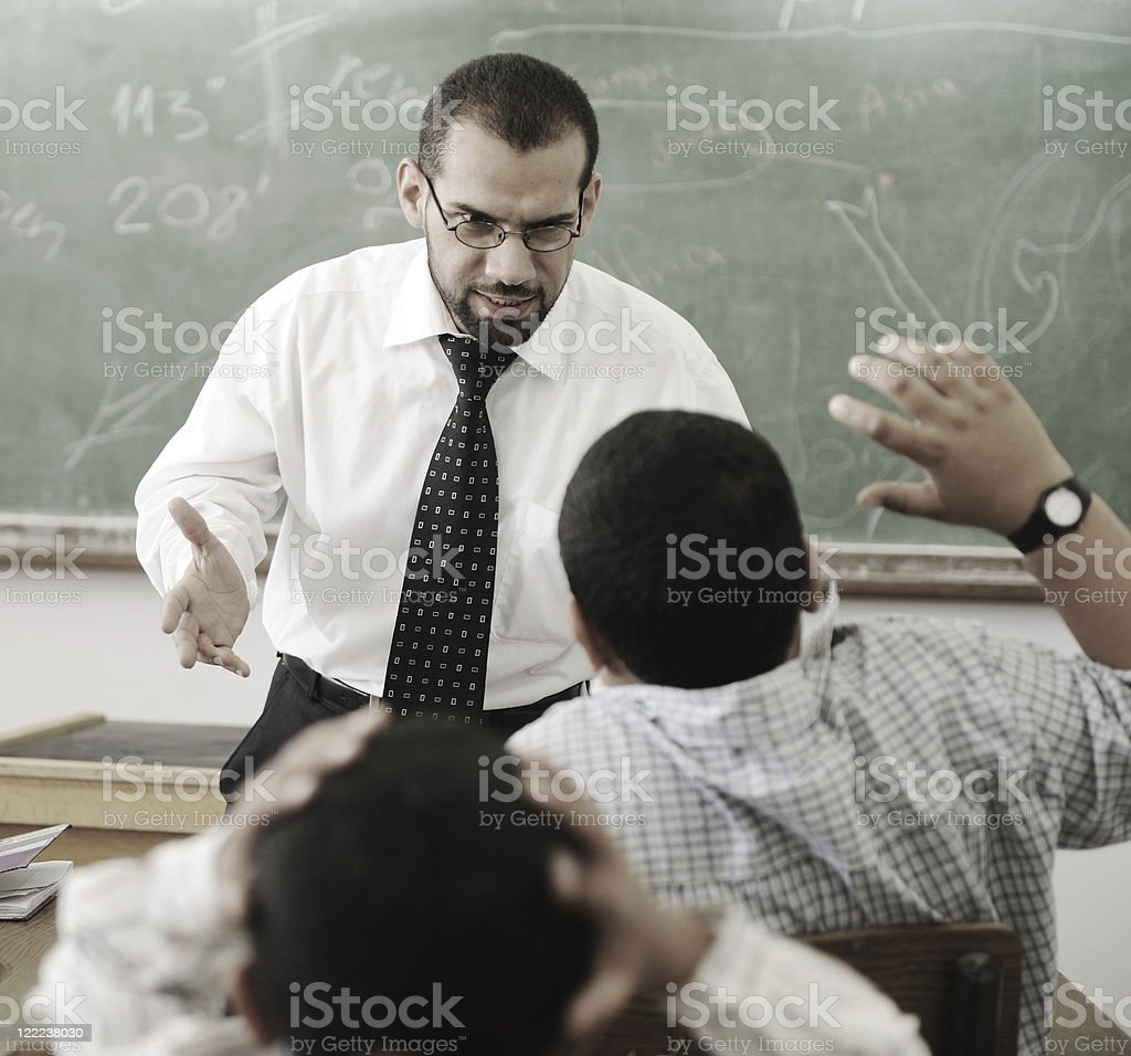 Education activities in classroom,   teacher yelling at pupil stock photo