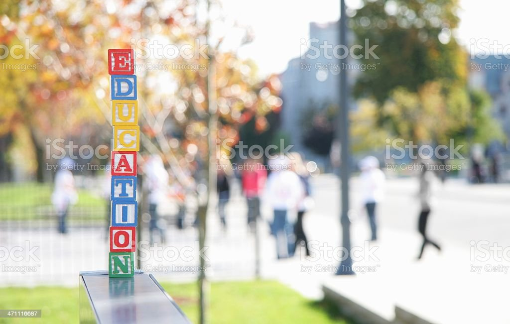 Education Alphabet Blocks with Campus in Background. stock photo