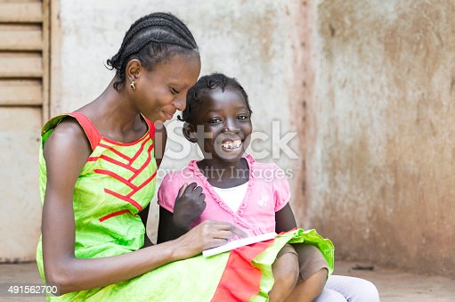 istock Education and Happiness: African Girls Learning Together Their Lessons 491562700