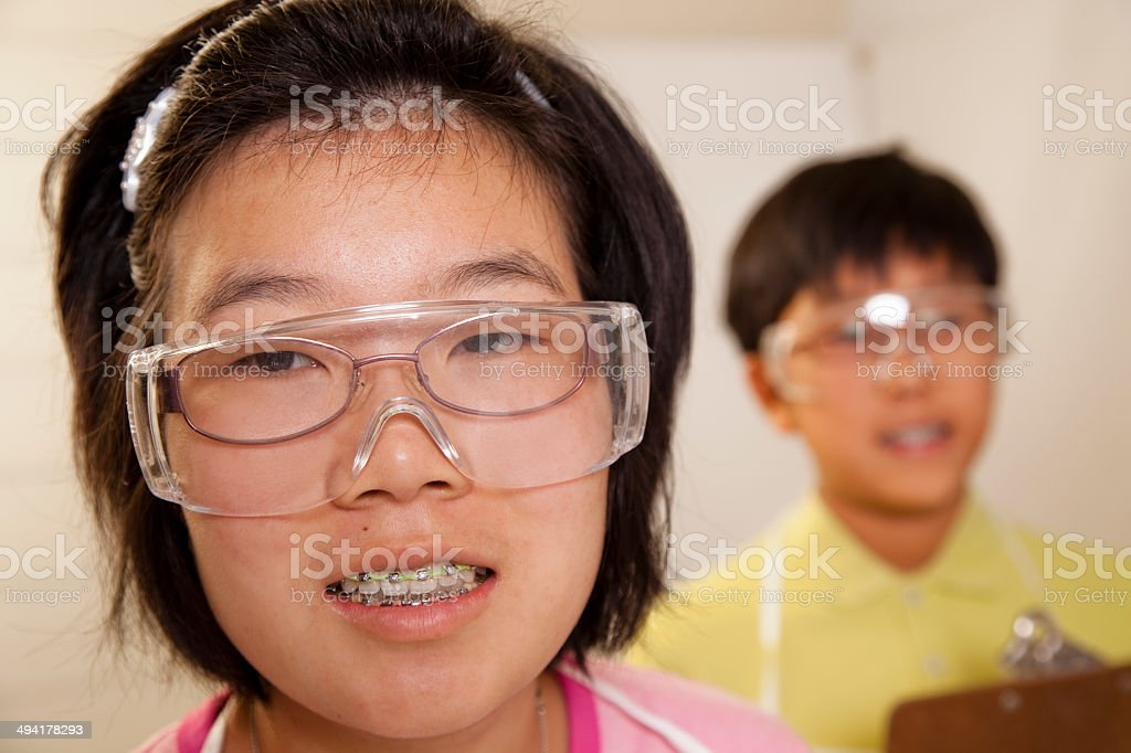 Education: Asian descent students in school science classroom. stock photo