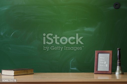 istock Education background with copy space. Student or teacher desk table on blackboard background. Classroom. Back to school. 936625578