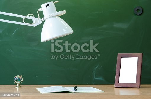istock Education background with copy space. Student or teacher desk table. Classroom. 936624974
