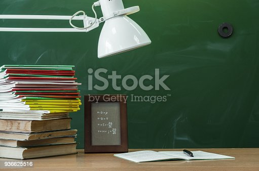 istock Education background with copy space. Student or teacher desk table. Classroom. 936625516