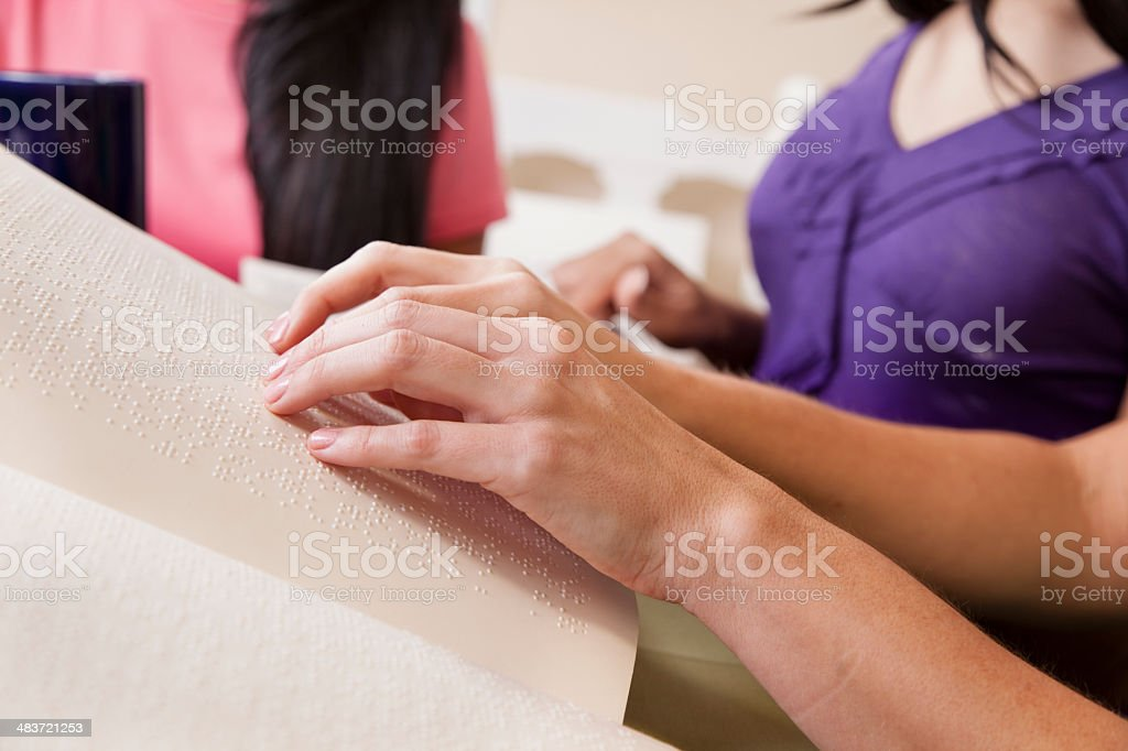 Education: Blind woman learns to read braille. stock photo