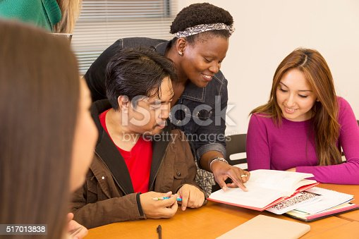 istock Education: College students, teacher collaborate in class. 517013838