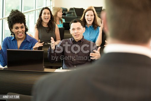 istock Education: College students with professor in lecture hall. 486141138