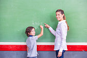 Education concept. Back to school. Teacher and schoolboy at the blackboard during math class