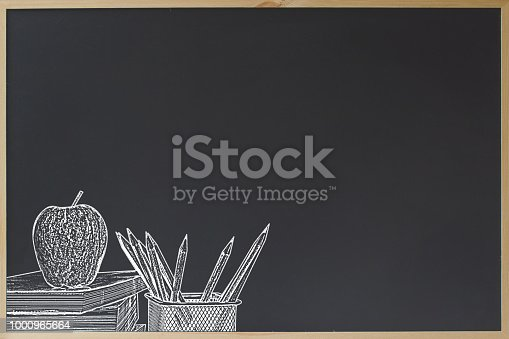 istock Education concept. Black chalkboard with pencil in basket and apple on stacked book chalk brush style. Back to school. Copy space for text. Chalkboard for sale offer advertising. 1000965664