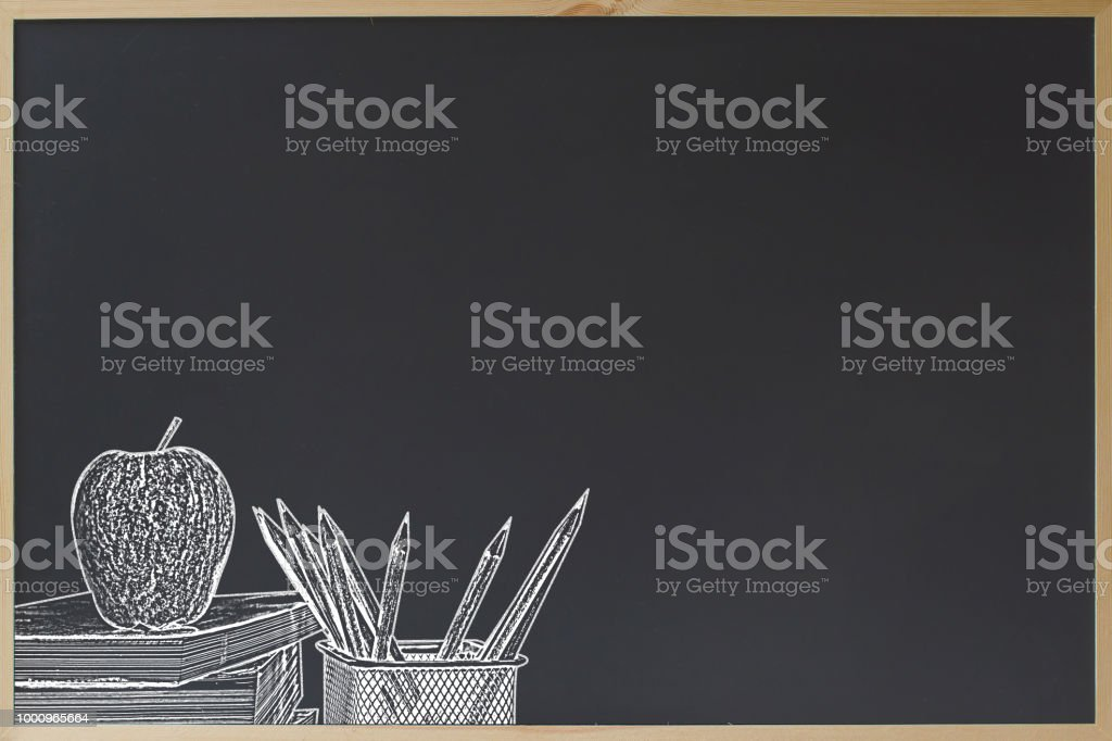 Education concept. Black chalkboard with pencil in basket and apple on stacked book chalk brush style. Back to school. Copy space for text. Chalkboard for sale offer advertising. stock photo