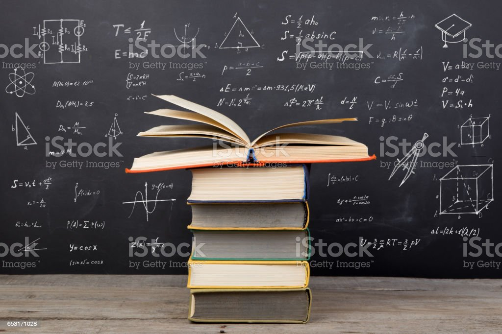 Education concept - books on the desk in the auditorium stock photo