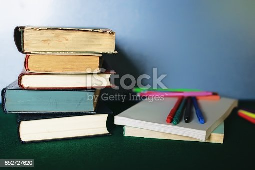 istock education concept books stack, apple and pen 852727620