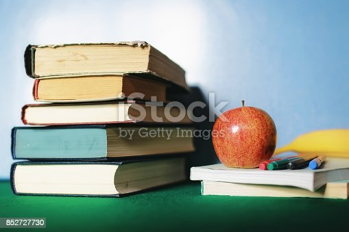 istock education concept books stack, apple and pen 852727730