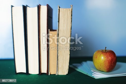 istock education concept books stack, apple and pen 852728512