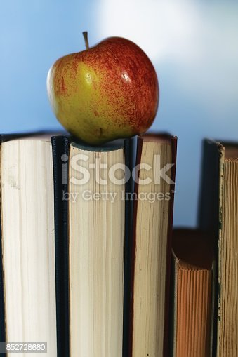 istock education concept books stack, apple and pen 852728660
