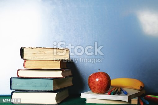 istock education concept books stack, apple and pen 857618416