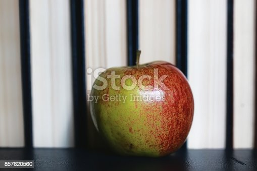 istock education concept books stack, apple and pen 857620560