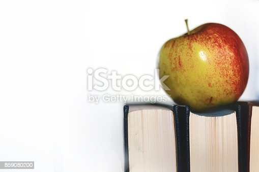 istock education concept books stack, apple and pen 859080200