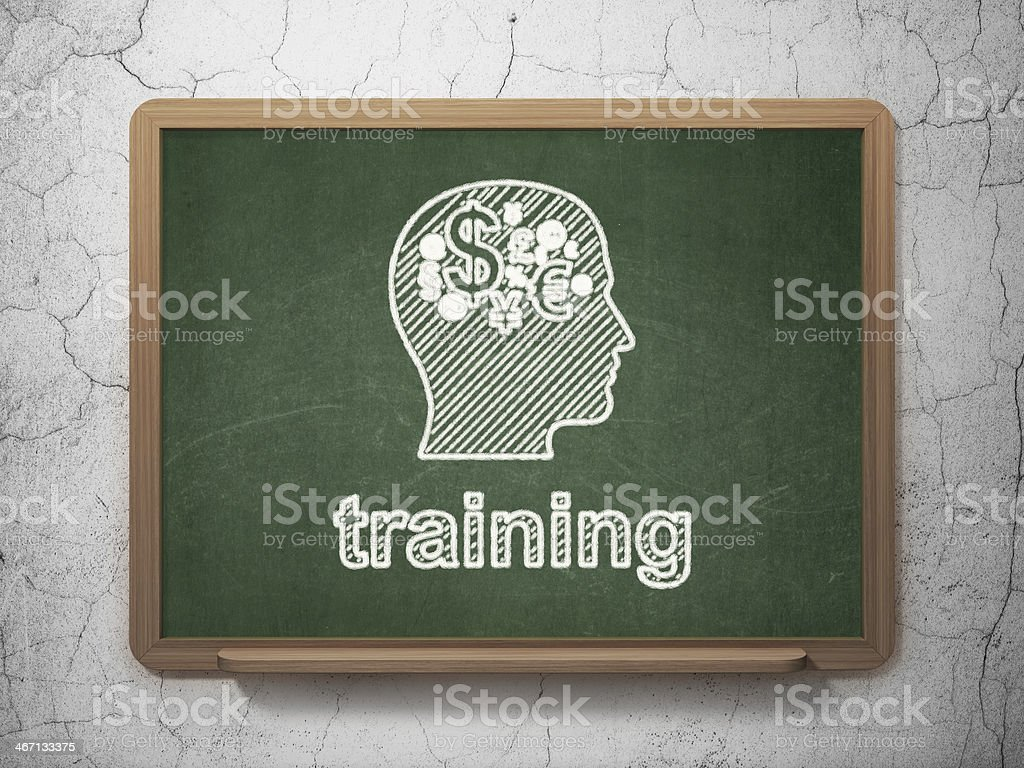 Education concept: Head With Finance Symbol and Training on chalkboard stock photo