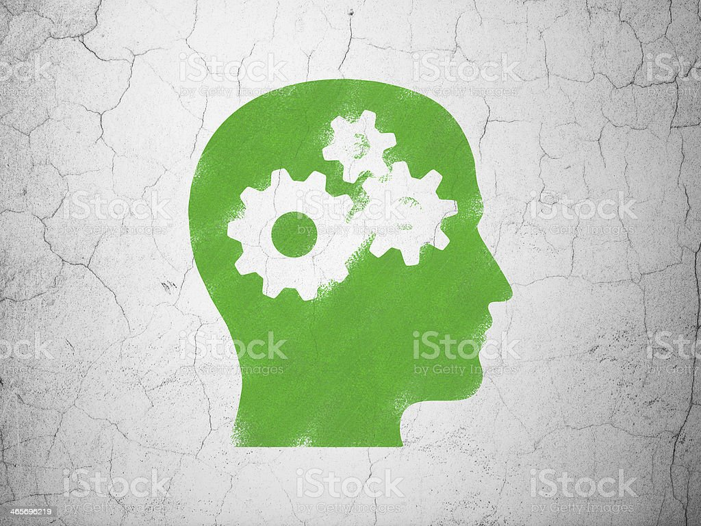 Education concept: Head With Gears on wall background stock photo
