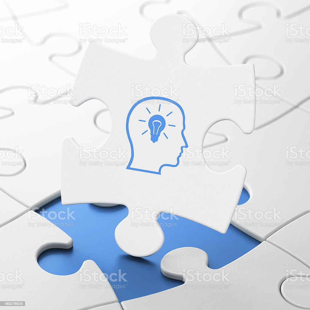 Education concept: Head With Lightbulb on puzzle background stock photo