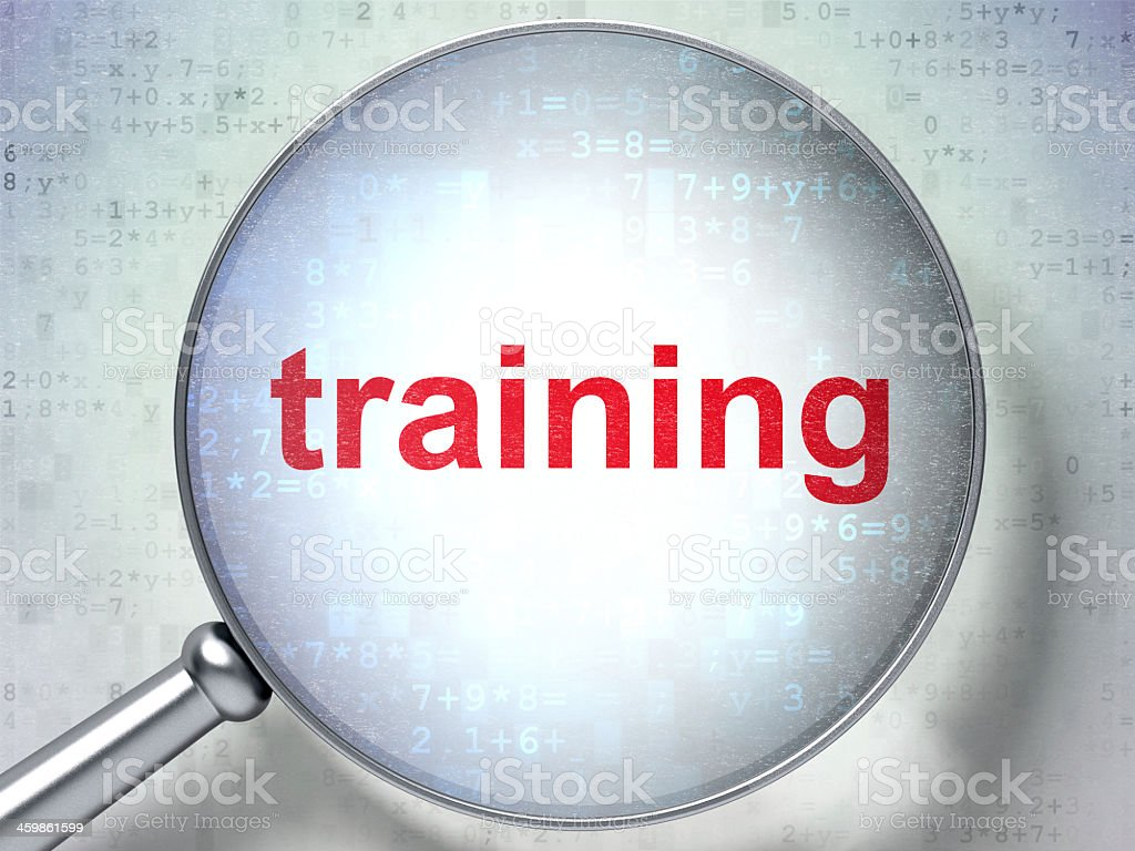 Education concept magnifying glass over the word 'training' stock photo