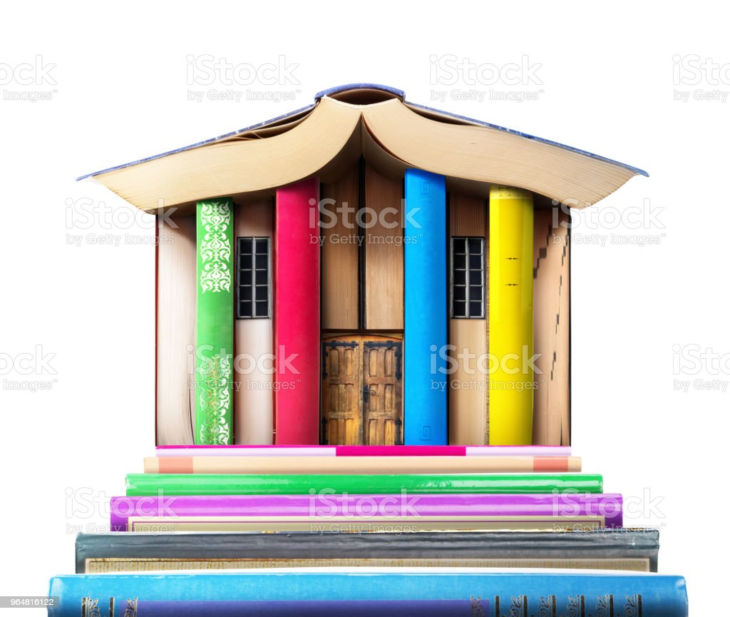 Education concept. Stack of books in form of a building on a white background. Library compiled from the books. royalty-free stock photo