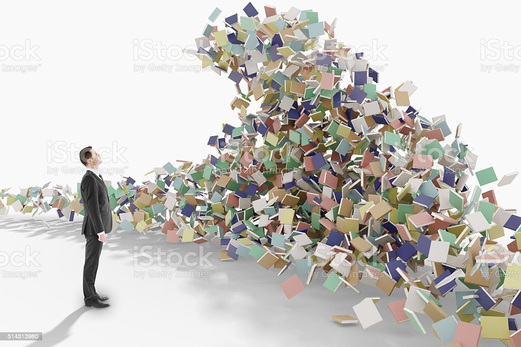 Education concept with businessman looks at the mountain of book stock photo