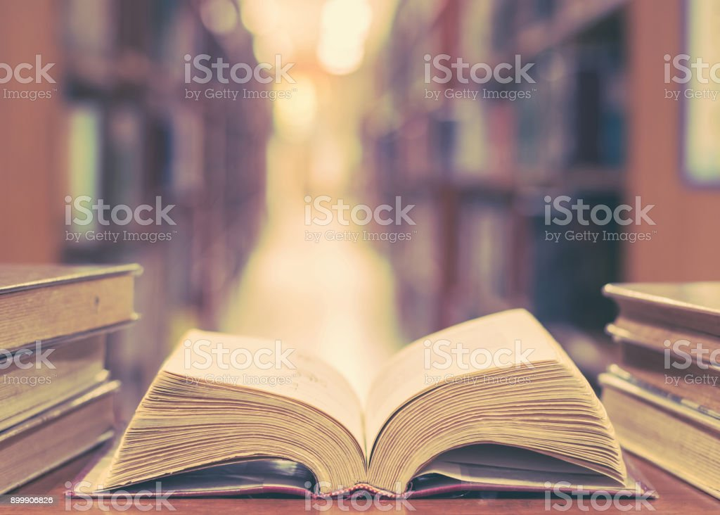 Education concept with old book in library stock photo