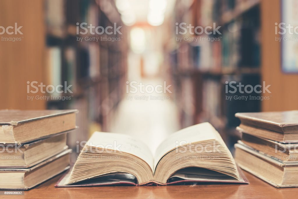 Education concept with old book in library royalty-free stock photo
